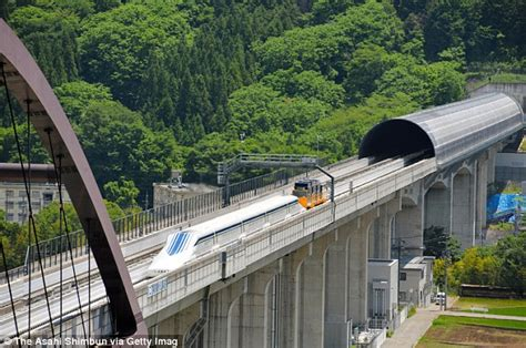 Floating by at 311mph: Japanese 'Maglev' bullet train